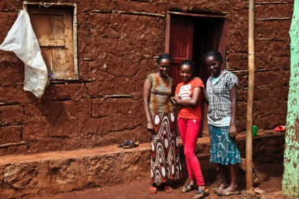 Meron with her mother Abinehbech and sister Kidist outside their home. (Photo: GGRF)